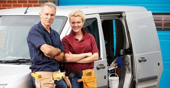 workers leaning on van